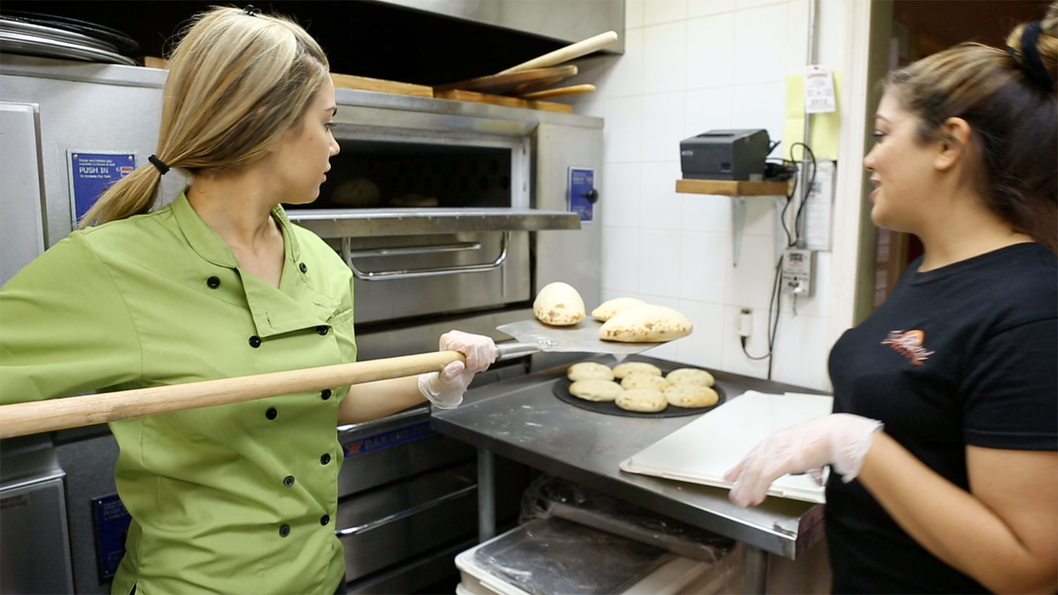 The Esendemir Sisters baking bread at Flatbread Grill.